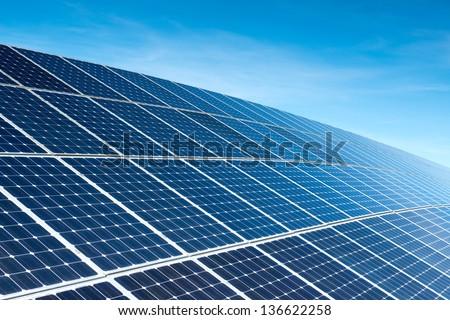 Solar Panels Against The Deep Blue Sky Royalty-Free Stock Photo #136622258