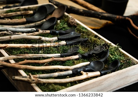 Handcrafted  wooden spoons on a table, layout. Green moss. #1366233842