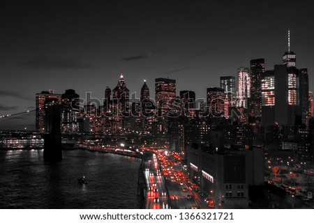 New York City black and white night skyline with red lights glowing in downtown Manhattan NYC
