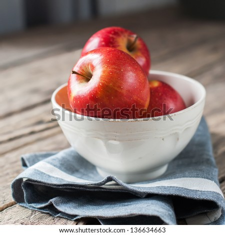Composition with Red Apples on the dark wooden table, square image #136634663