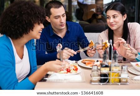 teenagers friends on breakfast in cafe #136641608