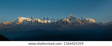 View of the Himalayan giants, Dhaulagiri  mountain, Annapurna range and Machapuchare (Fish Tail) mountain as seen at sunrise from Sarangkot village, near Pokhara, Nepal Himalayas, Nepal #1366425359