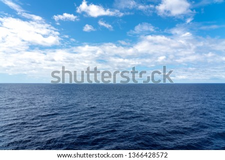 Atlantic Ocean Seascape - Ocean waves with blue sky and clouds Royalty-Free Stock Photo #1366428572
