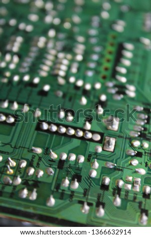 Velykyy Bychkiv, Transcarpathian region - April 9,2019: Microcircuits with tracks, resistors, sealed paths, transistors, diode, capacitors, transformers, coils, and radiators, Ukraine  #1366632914