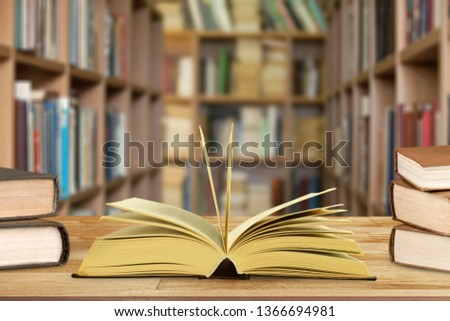 Book in library with old open textbook, #1366694981