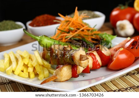 Chicken shish kebab on plate #1366703426