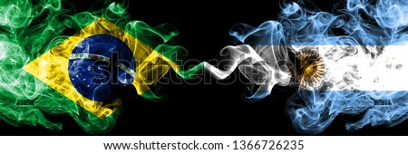 Brazil vs Argentina, Argentinian smoke flags placed side by side. Thick colored silky smoke flags of Brazilian and Argentina, Argentinian #1366726235