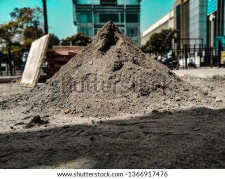 a heap of concrete.the heap resemblance like the artificial graphite mountain  and this can be used as for any industrial photos.the heap of mud ,the heap of sand #1366917476