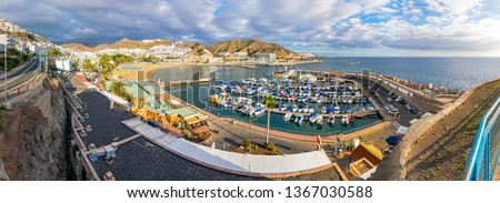 Panoramic aerial view of sea port and small bay of Puerto Rico de Gran Canaria holiday resort. Gran Canaria island, Spain Royalty-Free Stock Photo #1367030588