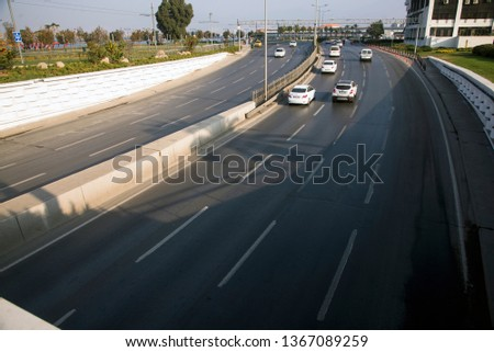 Izmir, Turkey - November 10, 2018: Top view of a road with 4 lanes with some vehicles. #1367089259