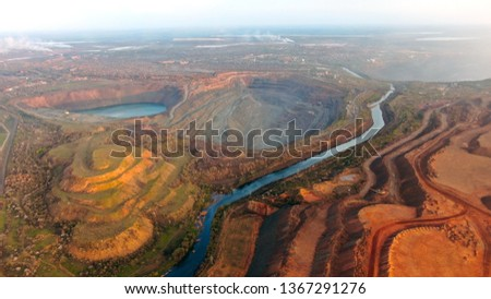 Quarry, mountains, nature from a height of flight, a beautiful landscape of an industrial city. Mining ore, city Krivoy Rog #1367291276