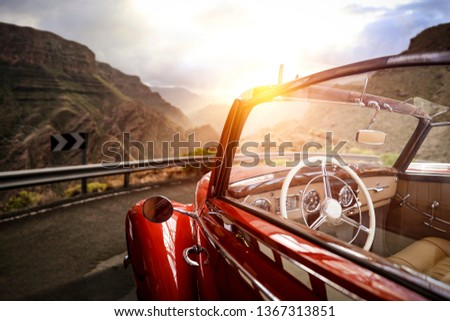 Summer car on road and sunset time in mountains. Free space for your decoration.  #1367313851