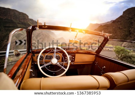Summer car on road and sunset time in mountains. Free space for your decoration.  #1367385953