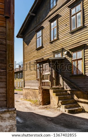 Scenic summer views of the Kalamaja streets of Tallinn, Estonia. Beautiful panorama of traditional colorful houses. Holiday, Vacation, Business, Transport Concept. #1367402855