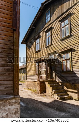 Scenic summer views of the Kalamaja streets of Tallinn, Estonia. Beautiful panorama of traditional colorful houses. Holiday, Vacation, Business, Transport Concept. #1367403302