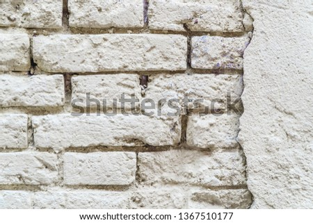 Texture of the old brick stylized wall with cracks close up #1367510177