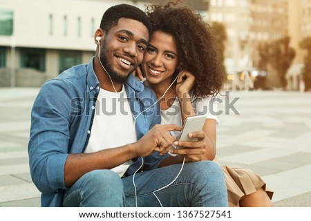 African-american couple dating, enjoying music outdoors, walking in city #1367527541