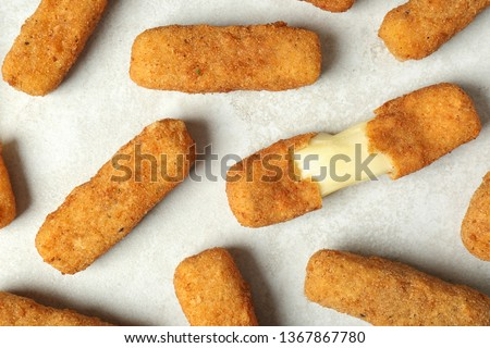 Tasty cheese sticks on grey background, top view Royalty-Free Stock Photo #1367867780