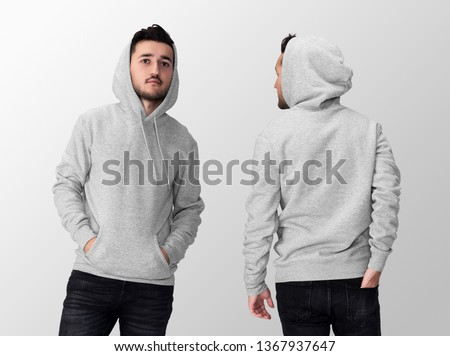 Heather grey blank hoodie on a young middle eastern man in jeans, isolated on a white studio background, front and back view mockup of heather grey hoodie with place for your logo or design #1367937647