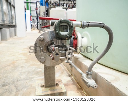 Level transmitter by pressure transmitter type was installed in power plant for monitor and control level tank. Royalty-Free Stock Photo #1368123326