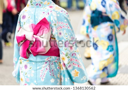 """Young girl wearing Japanese kimono standing in front of Sensoji Temple in Tokyo, Japan. Kimono is a Japanese traditional garment. The word """"kimono"""", which actually means a """"thing to wear""""  #1368130562"""