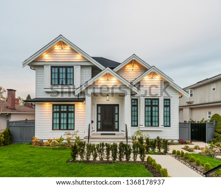 Luxury house at night in Vancouver, Canada. Royalty-Free Stock Photo #1368178937