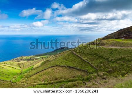 Hill of farm fields in the Corvo island in Azores, Portugal. #1368208241