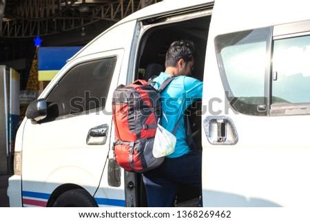 Backpack traveller travel using public van or mini bus in Thailand. #1368269462