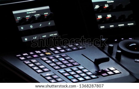 Blurry images of telecine controller machine transferring motion picture film into video and editing or adjusting in a color suite studio lab. which used in the movie post-production process