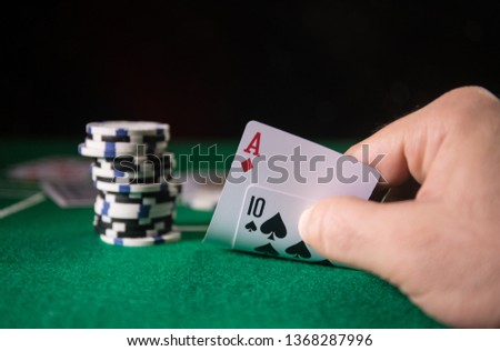 Cards and chips on green felt casino table. Abstract background with copy space. Gambling, poker, casino and cards games theme. Casino elements on green. Selective focus #1368287996