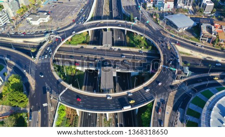 Aerial drone photo of multilevel highway junction urban ring crossing road during rush hour #1368318650