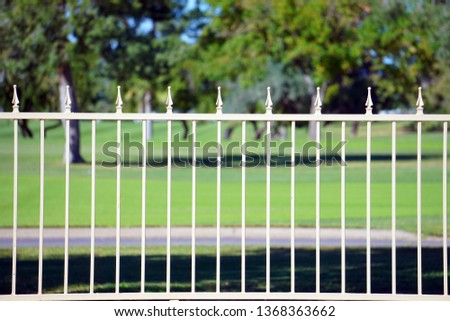 Iron Painted Fence on the edge of a golf course in a persons back yard      #1368363662