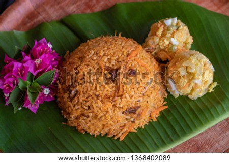 Rice with chicken, one of the most popular dishes in Panama. The list of ingredients includes cabbage, carrots, celery, bell pepper, onions, garlic, cilantro and if desired; peas, olives or raisins #1368402089