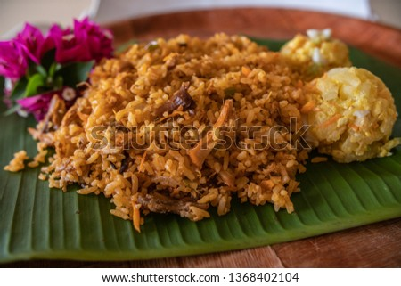 Rice with chicken, one of the most popular dishes in Panama. The list of ingredients includes cabbage, carrots, celery, bell pepper, onions, garlic, cilantro and if desired; peas, olives or raisins #1368402104