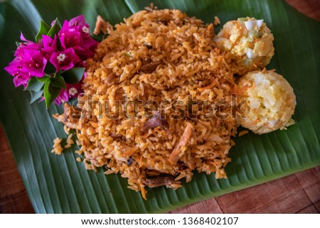 Rice with chicken, one of the most popular dishes in Panama. The list of ingredients includes cabbage, carrots, celery, bell pepper, onions, garlic, cilantro and if desired; peas, olives or raisins #1368402107