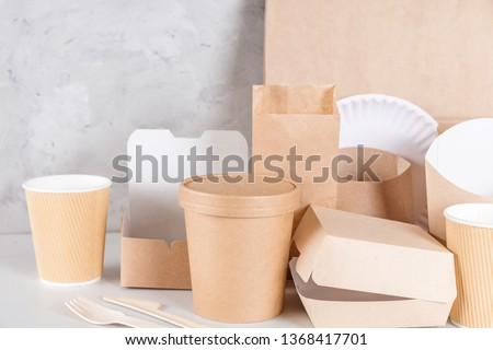 Eco friendly disposable tableware. Paper cups, dishes, bag, fast food containers and bamboo wooden cutlery. recycling concept #1368417701