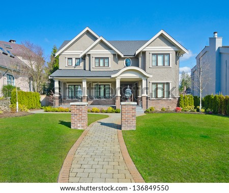 Big custom made luxury house with long doorway and nicely trimmed front yard in the suburbs of Vancouver, Canada. #136849550