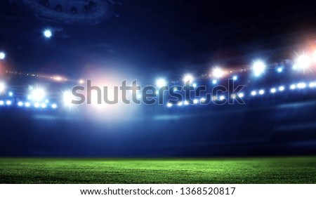 Empty night football arena in lights #1368520817
