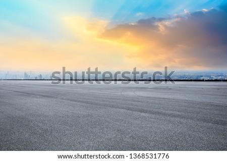 Shanghai city skyline and asphalt race track ground scenery at sunrise #1368531776