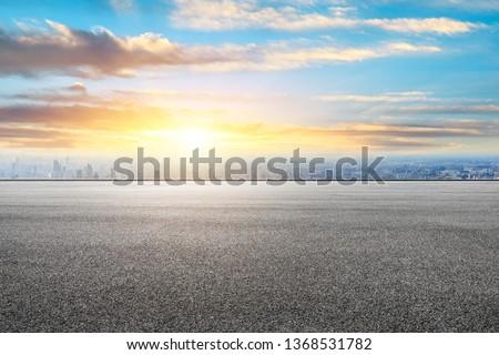 Shanghai city skyline and asphalt race track ground scenery at sunrise #1368531782