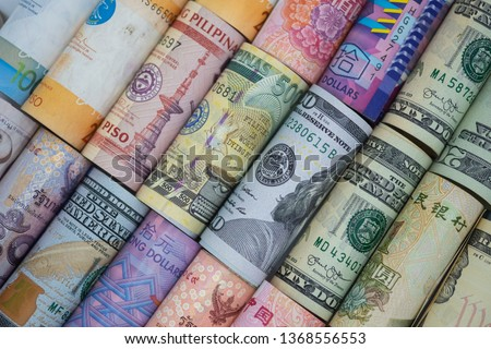 Closeup rolled of variety banknote around the world. Exchange rate and Forex investment concept.-Image. #1368556553