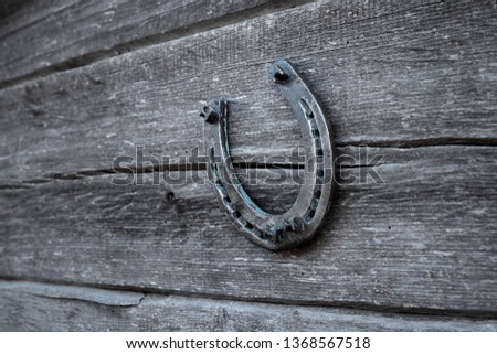 Old horseshoe on an old wooden board. The concept of luck, luck, luck. #1368567518