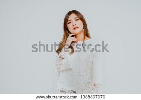 Beautiful caucasian female model wearing Baju Kebaya (Malay traditional dress) isolate over white background.