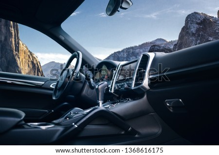 Expensive car interior with steering wheel, multimedia and gearbox handle #1368616175