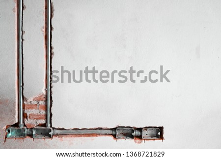 power receptacle steel boxes and conduit have install in the old brick wall #1368721829