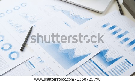 businessman working data document graph chart report marketing research development  planning management strategy analysis financial accounting. Business  office concept. Royalty-Free Stock Photo #1368725990