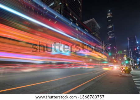 abstract image of blur motion of cars on the city road at night #1368760757