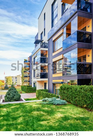 Modern complex of apartment residential buildings with green trees and outdoor facilities. #1368768935