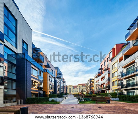 Modern complex of apartment residential buildings. Benches and outdoor facilities. #1368768944