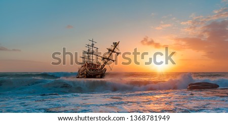 Sailing old ship in a storm sea in the background stormy clouds #1368781949
